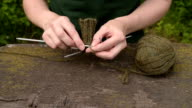 Woman knitting outdoors video