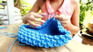 Woman knitting video