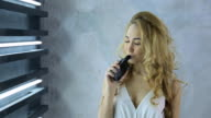 Woman laughs, smokes electronic cigarette, smiles. Pretty female with infectious laugh fool around video