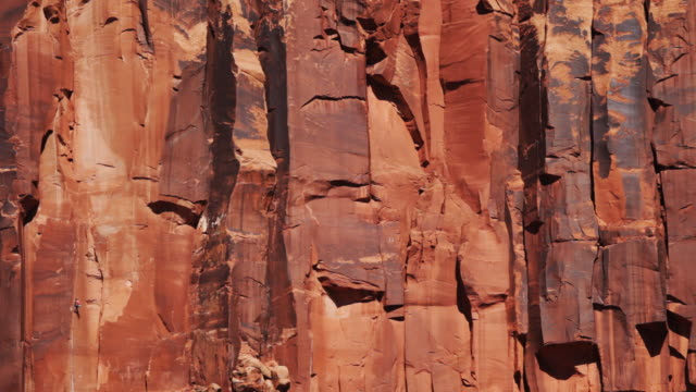 Woman lead climbing in canyon lands(the tiny dot) video