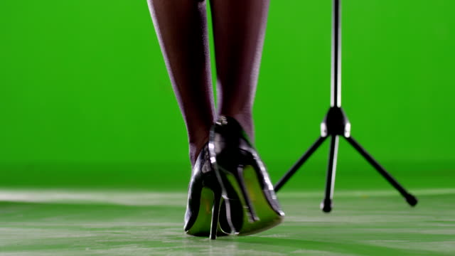 Woman legs. Female artist with microphone stand. Singing on green screen. Slow motion. Shot on RED EPIC Cinema Camera. video