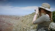 Woman Lifting Binoculars at Grand Canyon video