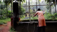 woman lifting water from the well video