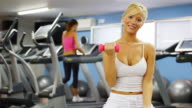 Woman lifting weights in the Gym video
