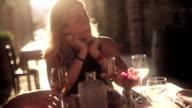 Woman listening a conversation in restaurant video
