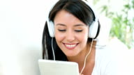 Woman listening to music at home video