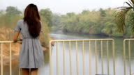 woman long hair standing alone in the nature video