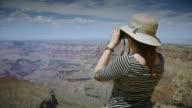 Woman Looking at Grand Canyon Through Binoculars video
