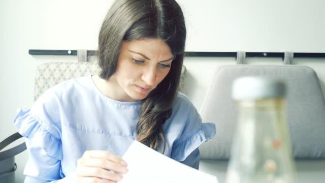 Woman looking at menu. video