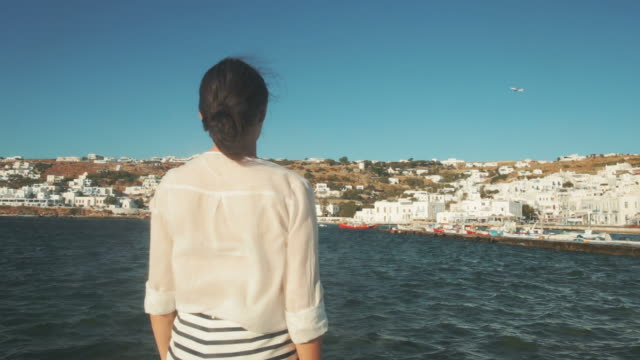 Woman looking at the view of Mikonos, Greece. video