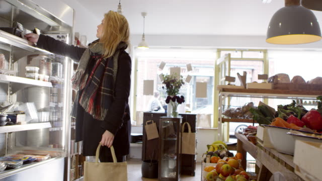 Woman Looking In Chilled Display Of Delicatessen Shot On R3D video