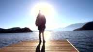 Woman looking sunset in the lake video