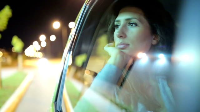 Woman looking trough the car glass video