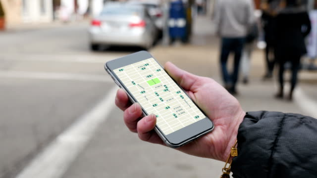 Woman Looks at Ride Sharing Traffic Patterns on Smartphone video