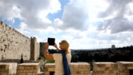 Woman looks off to old wall and city, Jerusalem, Israel video