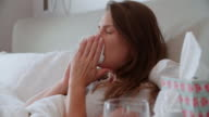 Woman Lying In Bed Suffering With Cold video