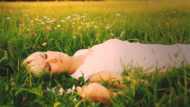 HD DOLLY: Woman Lying In Grass-Vintage Look video