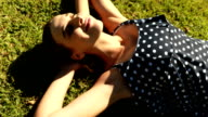 Woman lying on grass in park video