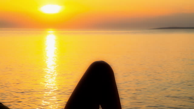 HD DOLLY: Woman Lying On The Beach At Sunset video