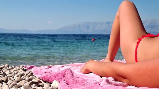 Woman lying on the beach video