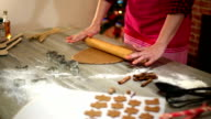 Woman make ginger bread for Christmas. Natural Colors. Real life video