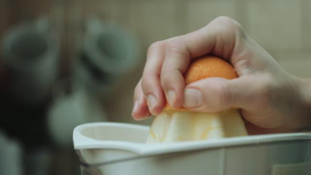 Woman makes orange fresh video
