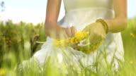 HD SLOW MOTION: Woman Making A Wreath Of Wildflowers video