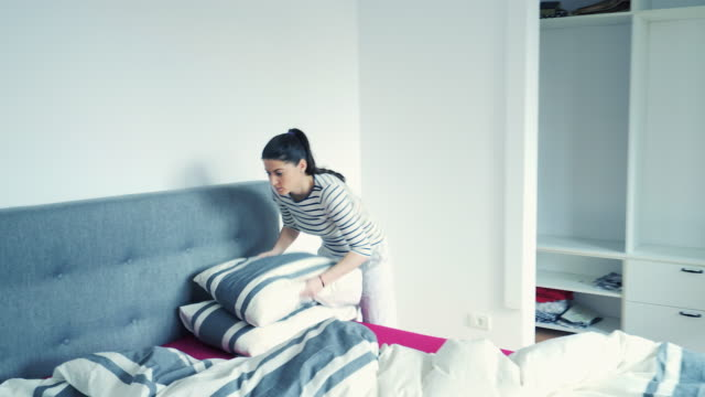 Woman making bed. video