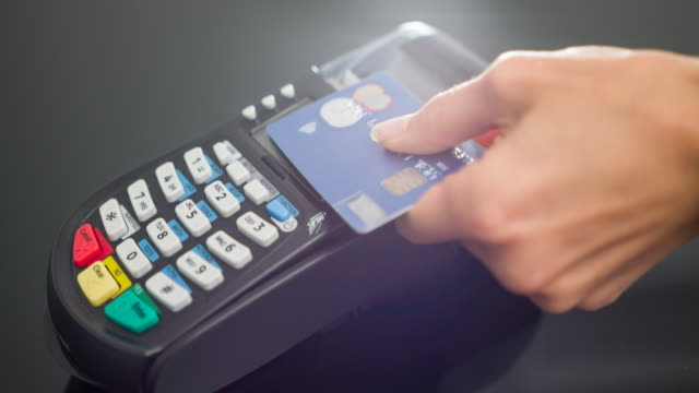 Woman making contactless payment with credit card video