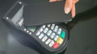 Woman making contactless payment with smartphone video