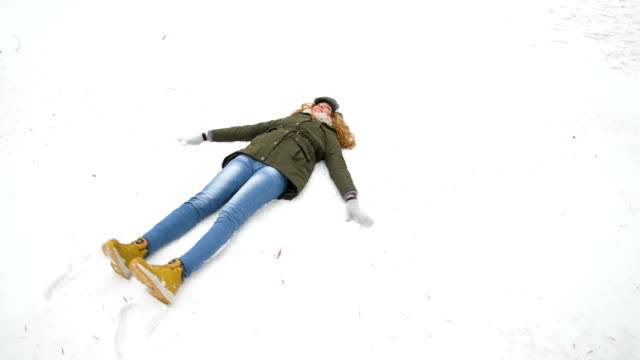 Woman making snow angel video