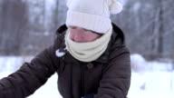 Woman making snowman video