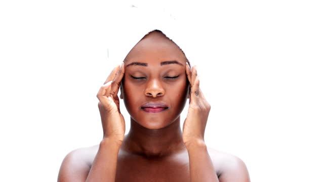 Woman massaging her head video