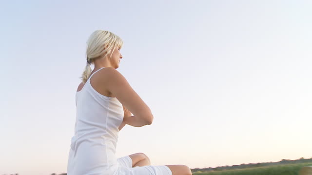 HD SLOW MOTION: Woman Meditating On A Hay Bale video