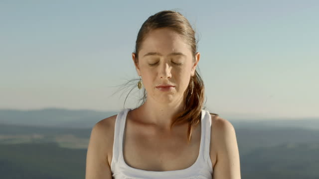 HD DOLLY: Woman Meditating On The Cliff video