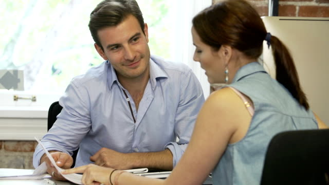 Woman Meeting With Financial Advisor In Office video