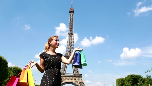 Woman olding shopping bags in Paris video