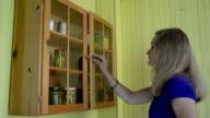 woman olive jar cabinet video