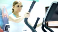 Woman on an exercise tape running in the gym. video