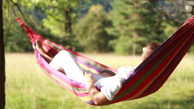Woman on hammock relaxing video