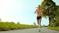 SLO MO TS Woman on her daily run through countryside video