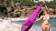 Woman On The Beach Holding Scarf video