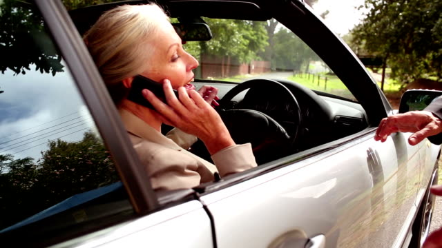 Woman on the phone sitting in her car video
