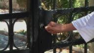 Woman open iron door video