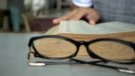 woman open old book and find at library video