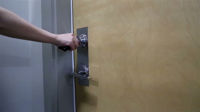 Woman opening apartment door video