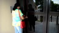 woman opening door video