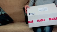 Woman opening parcel video