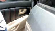 Woman opening the car door video