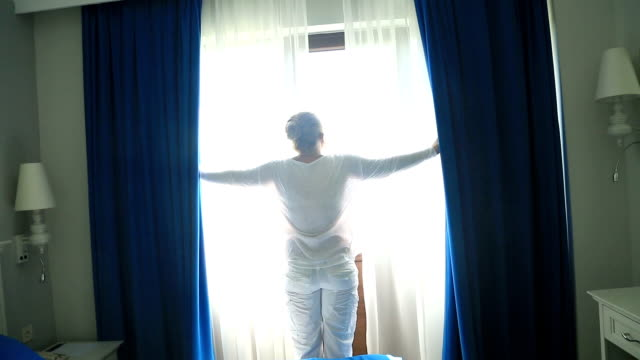 Woman Opens The Curtains video